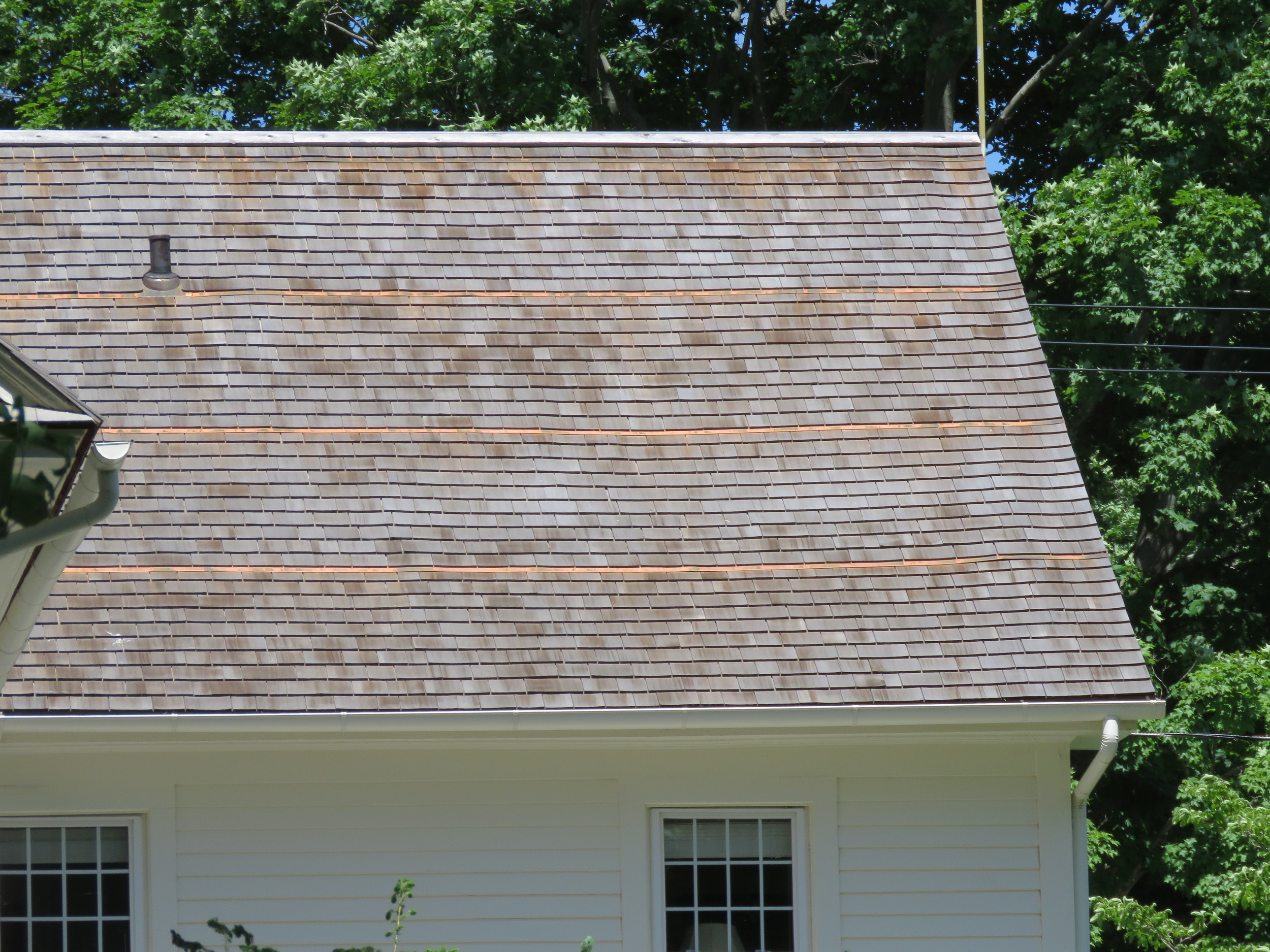 A fairly new cedar shingle roof. Note the copper strips installed to inhibit the growth of algae.
