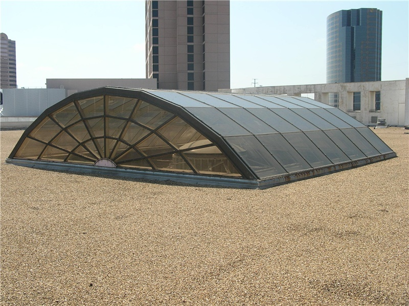 Barrel Vaulted flat end skylight on a built-up roof.
