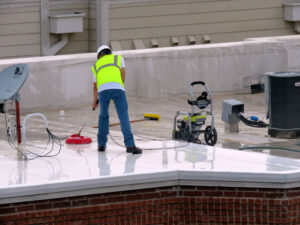 Some highly reflective roofs aren't so reflective after a few years. This white TPO roof is being professionally cleaned to maintain the energy savings gained from having a reflective roof.