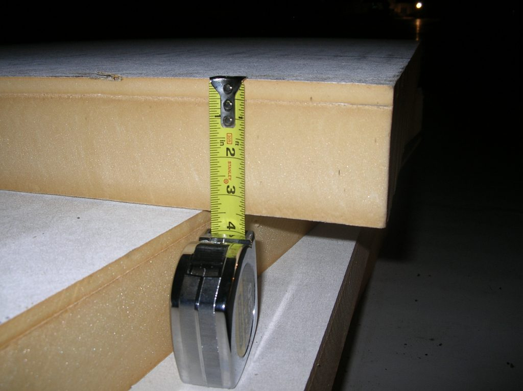 Composite polyiso insulation board. The denser, thinner layer acts as a cover board and is attached at the factory.