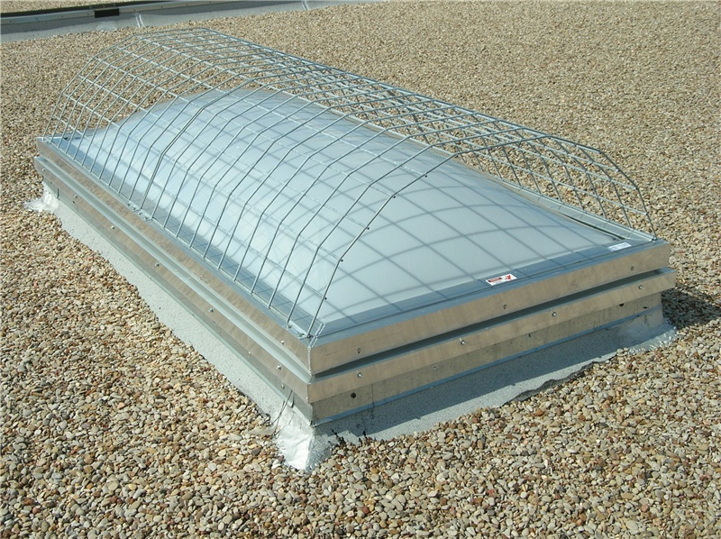 """A fusible link (or """"pop-up"""") type smoke vent with fall protection."""