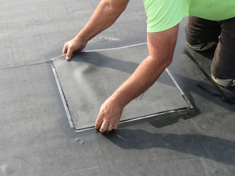 Carefully setting a peel-and-stick patch in place.