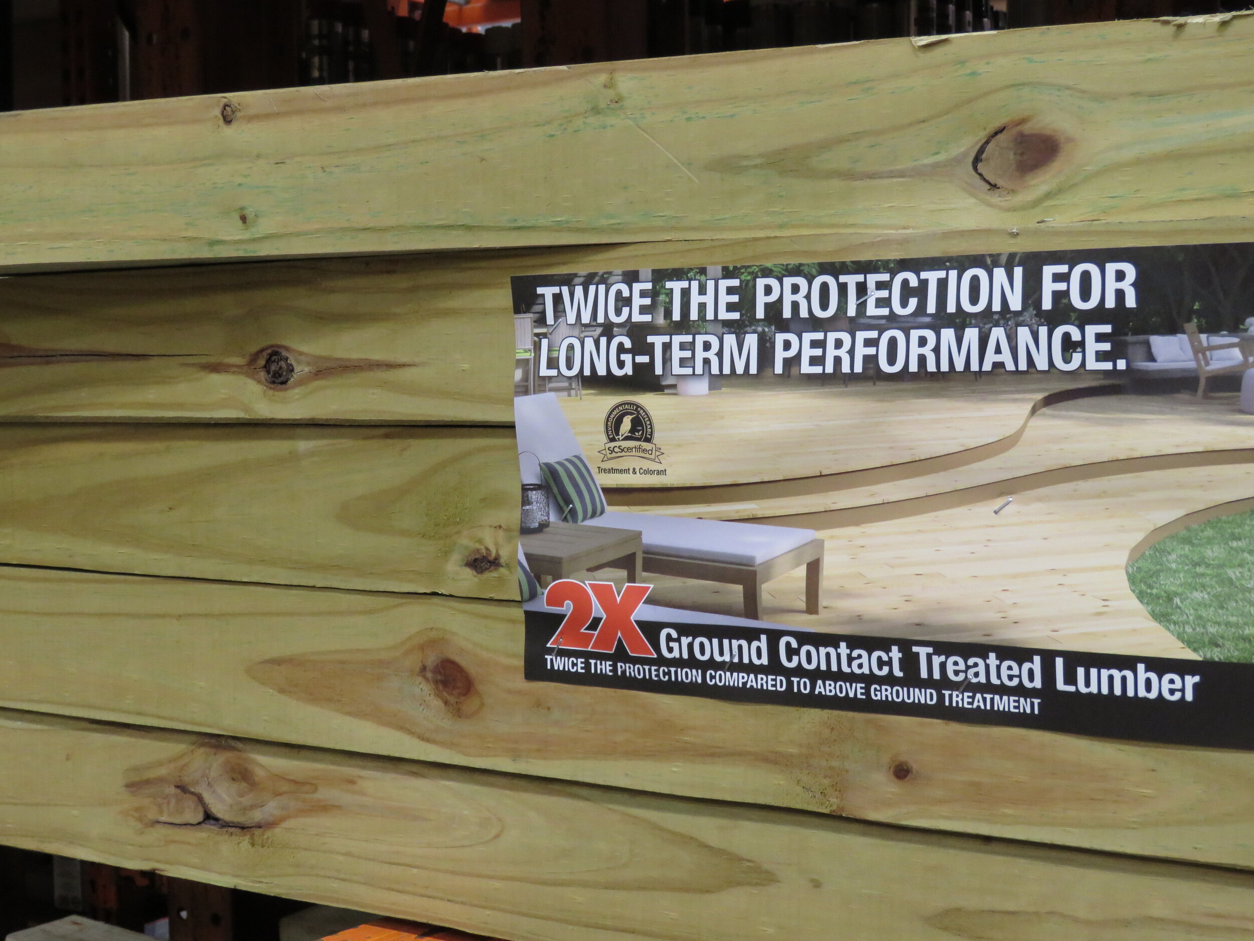 """A stack of """"Ground Contact"""" pressure-treated lumber. Other treatment designations relating to end-use applications include """"Above Ground"""", """"Foundation"""", and """"Marine""""."""