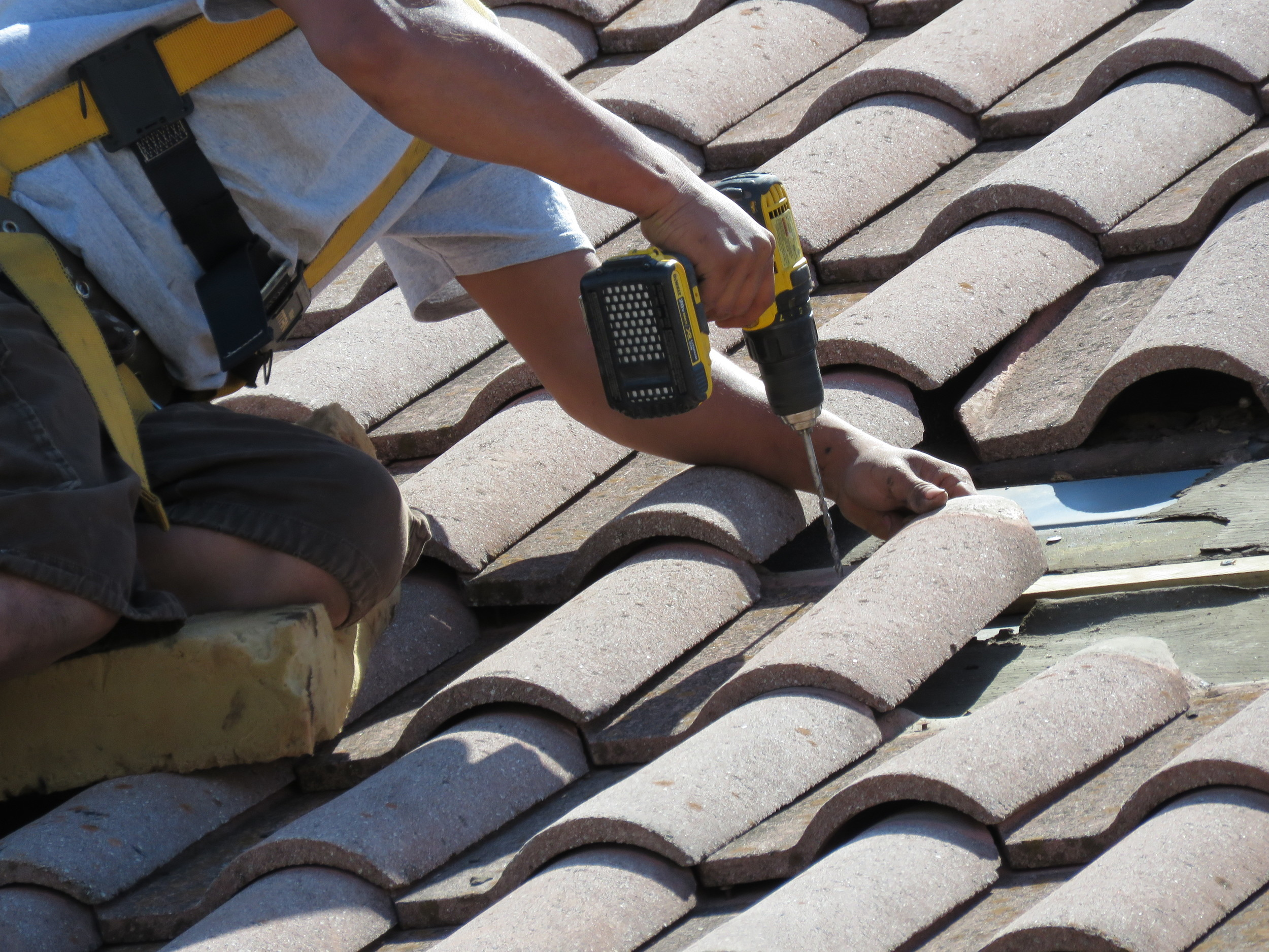 Fixing an older concrete tile roof. The wood battens had deteriorated, causing the fasteners to loosen.