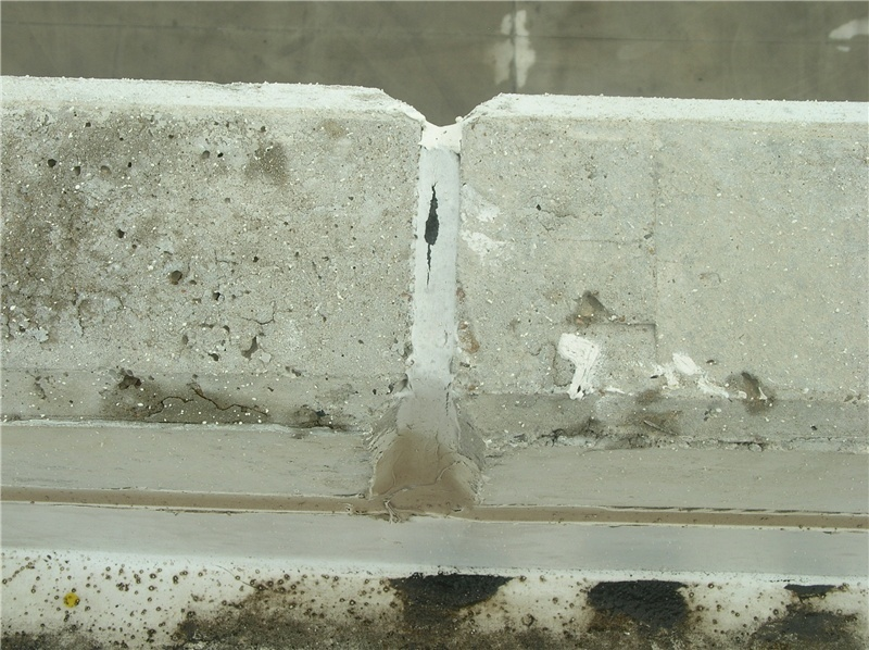Cohesive sealant failure at the top of a tilt-up wall joint.