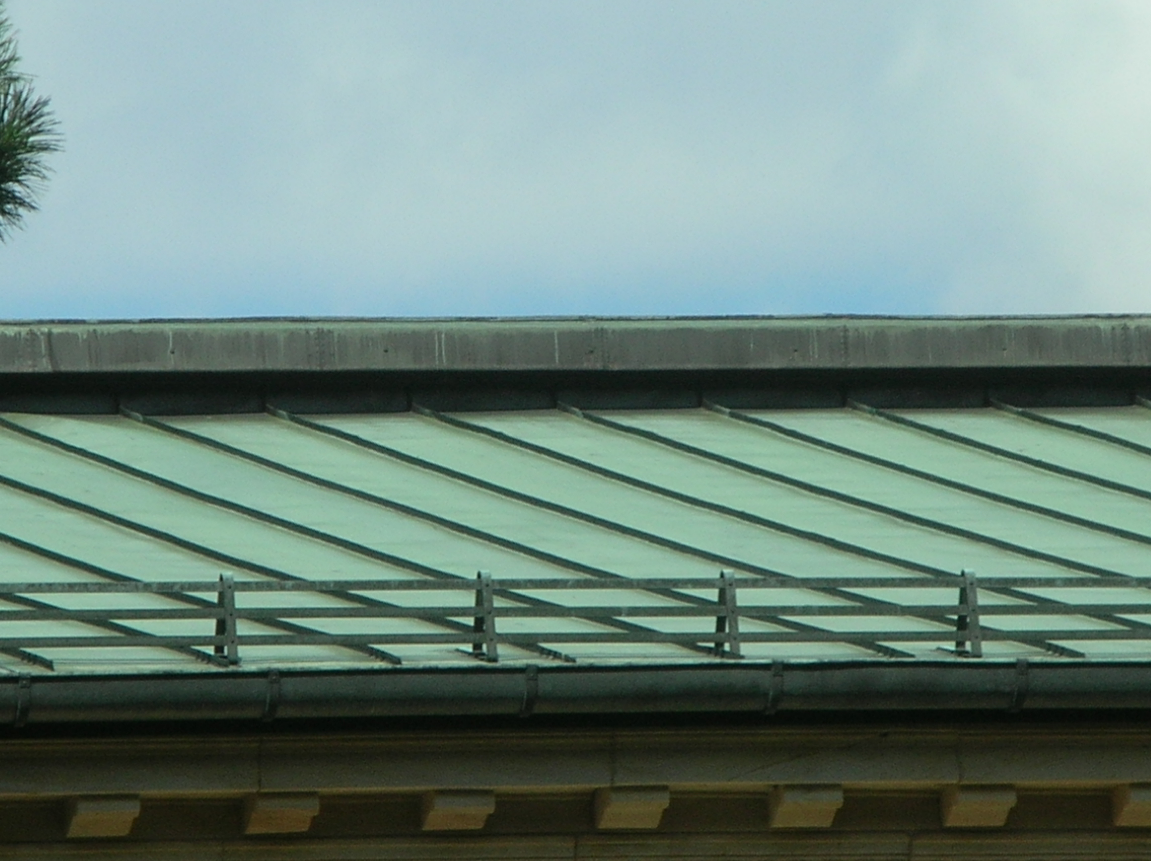 Section of a standing seam copper roof.