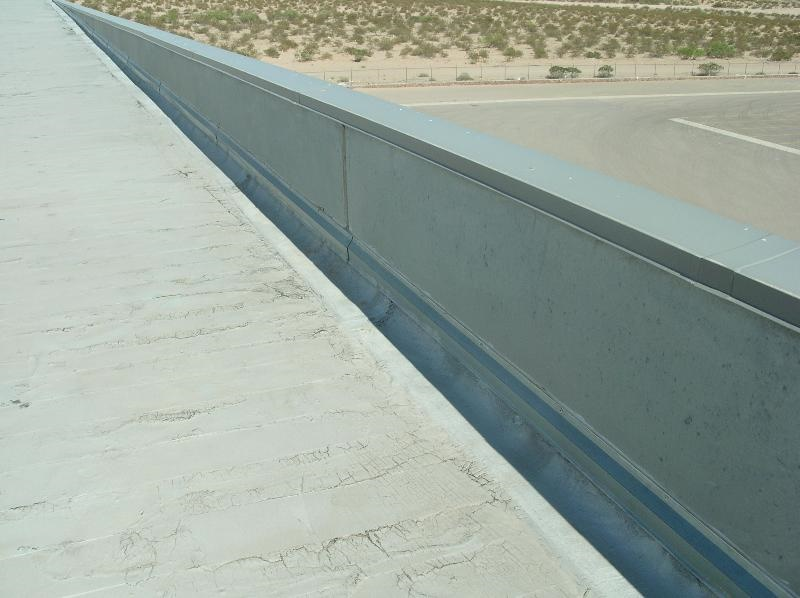 Tops of tilt-up wall panels functioning as a parapet wall.