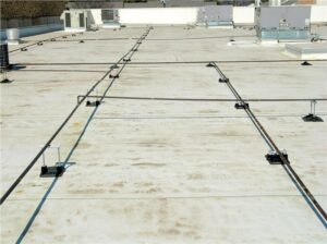 A white EPDM roof membrane installed on a commercial roof
