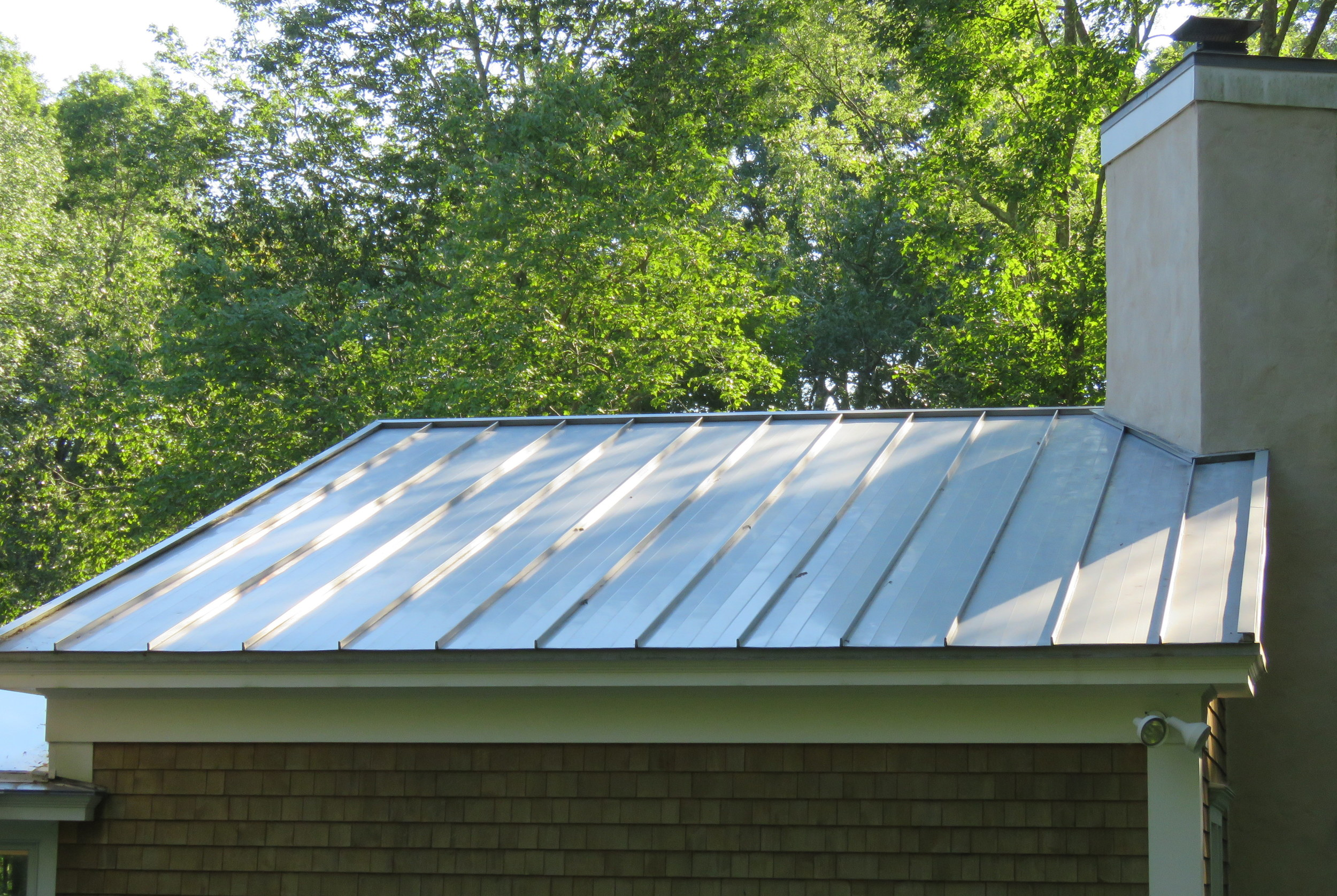 A white residential standing seam metal roof.