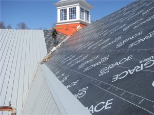 Peel-and-stick underlayment applied to the plywood roof deck during the installation of a standing seam metal roof.